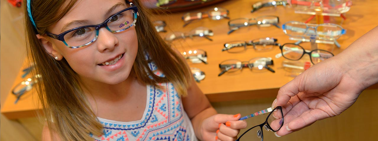 little girl trying on glasses - optometrist - Jackson & Ripley, TN
